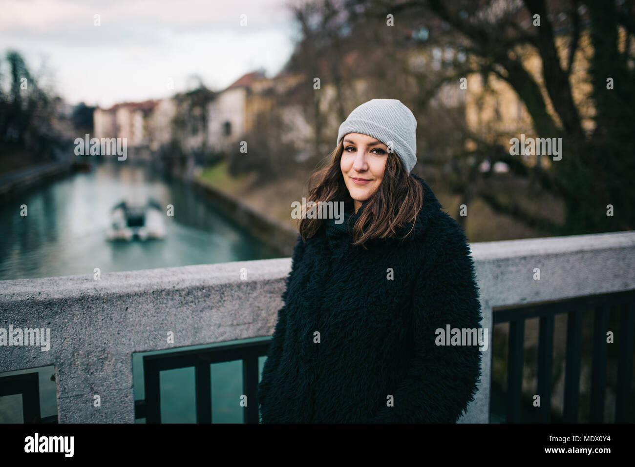 Woman standing on the bridge - Stock Image