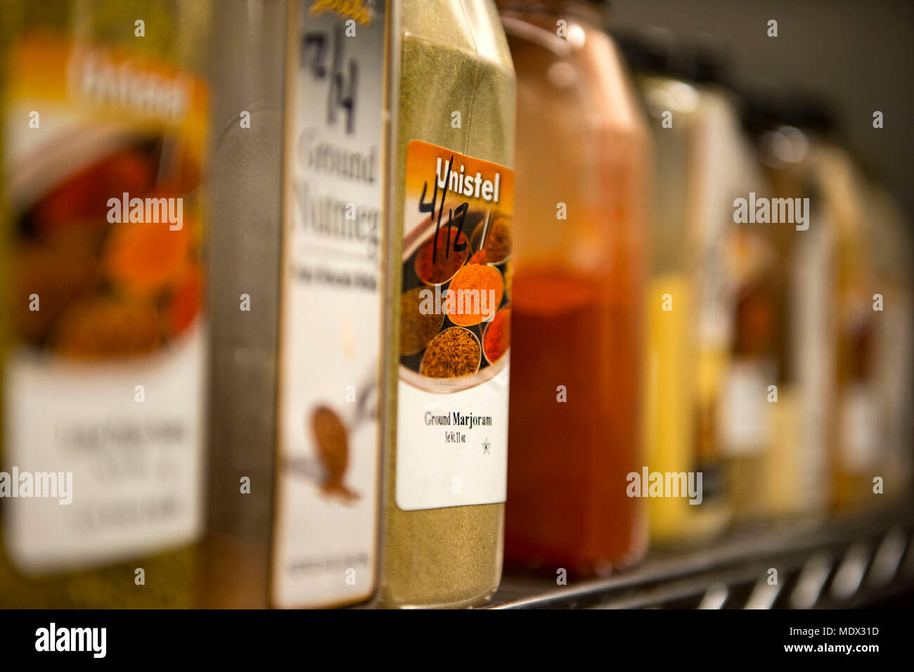 Spices rest on a rack in the Georgia Pines Dining Facility (DFAC), Dec. 12, 2017, at Moody Air Force Base, Ga. Through teamwork, adaption and striving for excellence, the Georgia Pines DFAC Airmen are able to ensure Team Moody is fed and ready to finish the fight. (U.S. Air Force Base photo by Airman 1st Class Erick Requadt) - Stock Image
