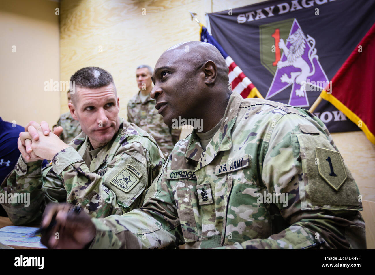 Sergeant Major of the Army Daniel A  Dailey (left), listens to