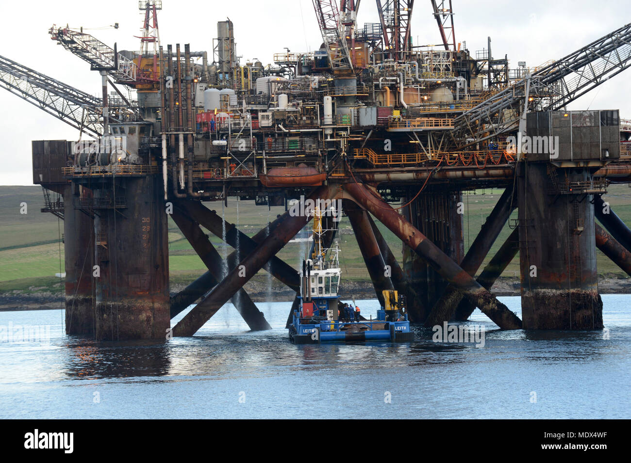 Buchan Alpha oil rig coming into to Lerwick Shetland for decommissioning to be cut up for scrap metal and be recycled - Stock Image