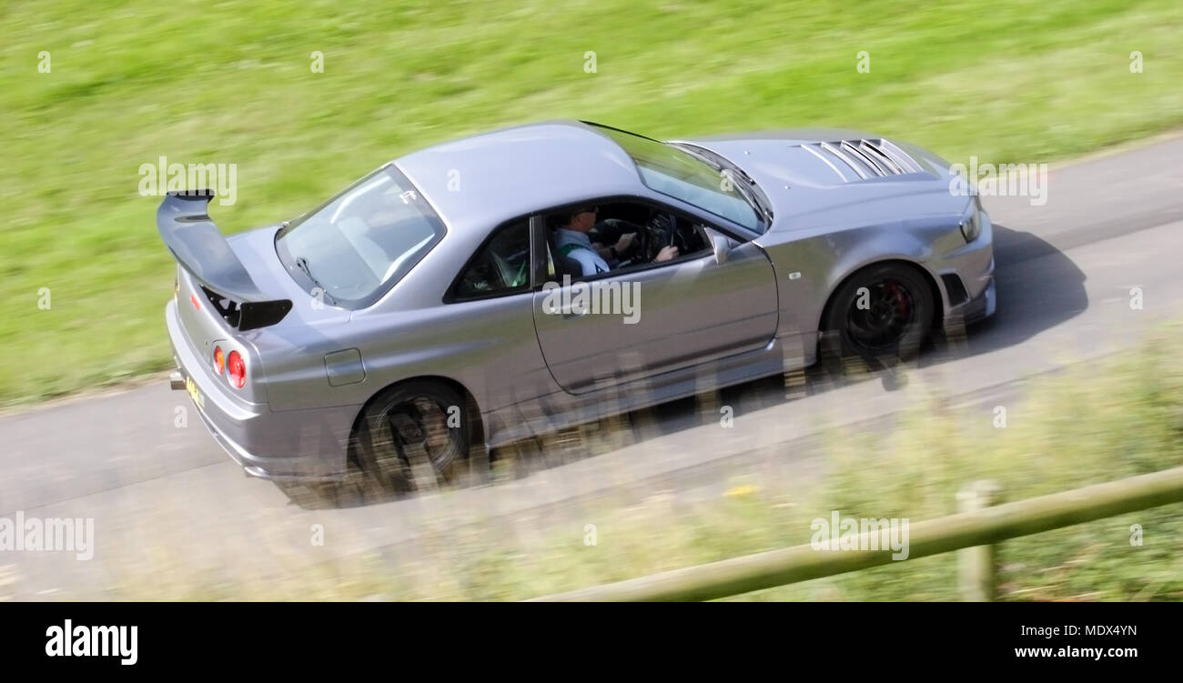 Silver Grey Nissan Skyline GTR R34 Car Driving Fast   Stock Image