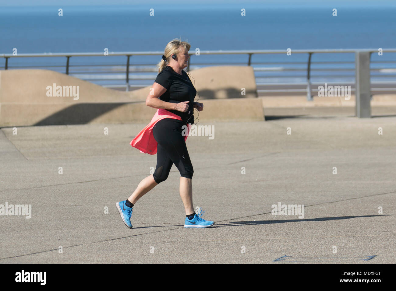 Blackpool Lancashire. UK Weather. 21/04/2018.  Sunny start to the day on the Fylde Coast as the north-west coast experiences the hottest temperatures so far this week. Credit: MediaWorldImages/AlamyLiveNews - Stock Image