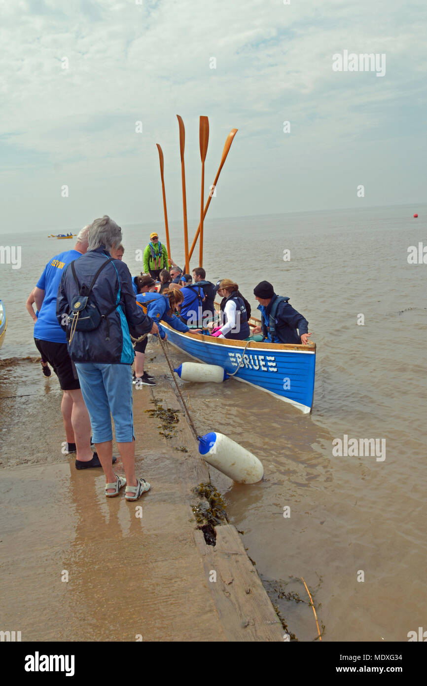 North Somerset, UK. 21st April, 2018.  A team of rowers in boat called Brue rowed from Bristol Marina to Clevedon seafront. They set off at 10.30 and arrived at 13.20 approx having covered 15miles with plenty of excitement on the way coming round Portishead with large shipping boats in the channel. Robert Timoney/Alamy/Live/News Credit: Robert Timoney/Alamy Live News - Stock Image