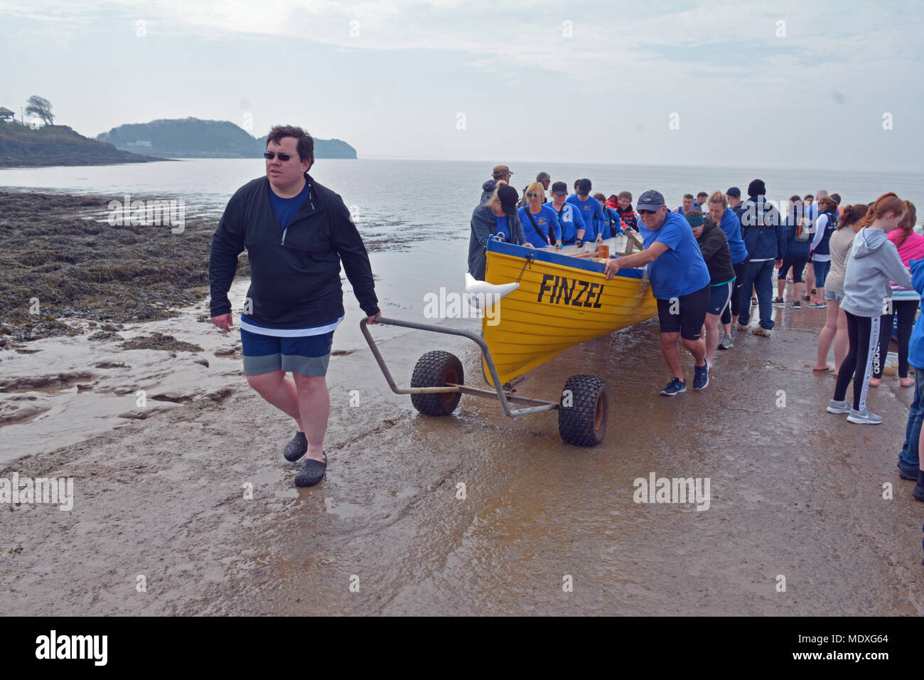 North Somerset, UK. 21st April, 2018.  A team of rowers in boat called Finzel rowed from Bristol Marina to Clevedon seafront. They set off at 10.30 and arrived at 13.20 approx having covered 15miles with plenty of excitment on the way coming round Portishead with large shipping boats in the channel. Robert Timoney/Alamy/Live/News Credit: Robert Timoney/Alamy Live News - Stock Image