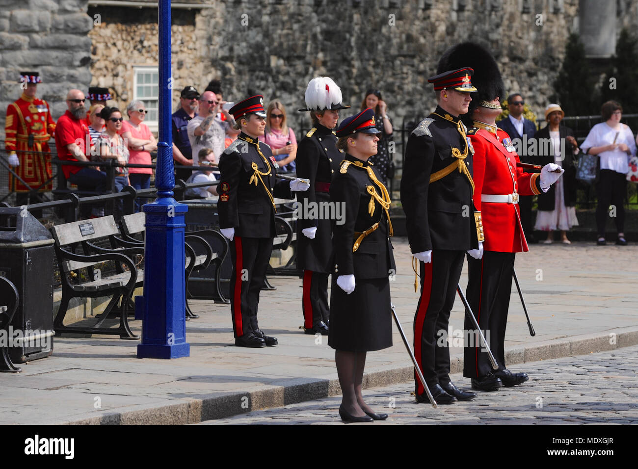 London, UK. 21st April 2018. Officers of The Honourable Artillery Company (HAC, the City of London's Reserve Army Regiment) standing at attention outside the Tower of London prior to a 62 Gun Salute to mark the 92nd birthday of HM Queen Elizabeth II, London, England, United Kingdom.   The HAC dates its origins to 1537 making it the oldest regiment in the British Army. It took over the role of firing Gun Salutes from the Tower of London in 1924 when the regular detachment stationed there was disbanded. Credit: Michael Preston/Alamy Live News - Stock Image