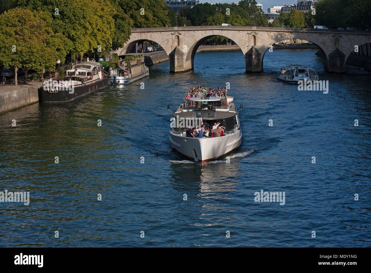 Paris, Île Saint Louis, view from the Pont Louis Philippe, tourist boat, Pont Marie - Stock Image