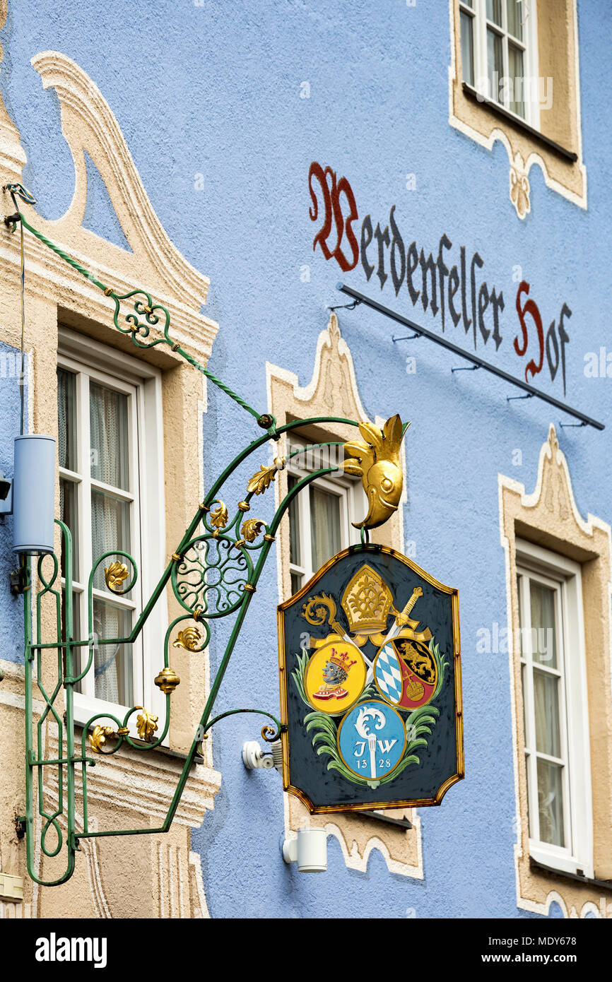 Close-up of a metal gold sign on side of colourful building; Grainau, Bavaria, Germany - Stock Image