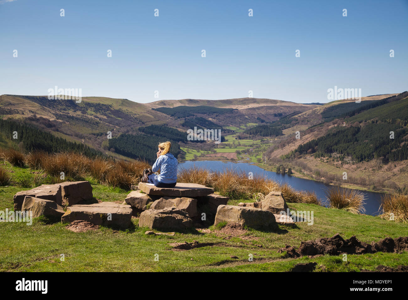 Woman Looking Down onto the Talybont Valley and Reservoir in the Brecon Beacons National Park - Stock Image