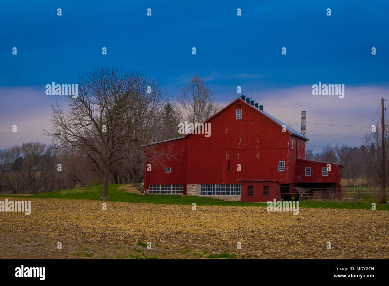 outdoor view of wooden red house building located in amish country