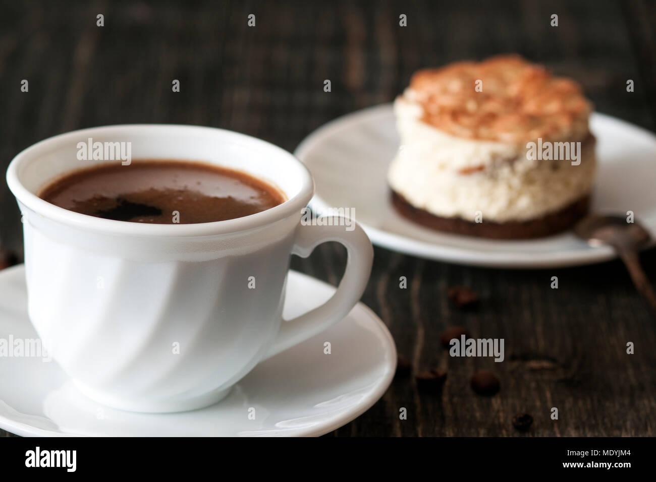 a cup of coffee and tiramisu Stock Photo