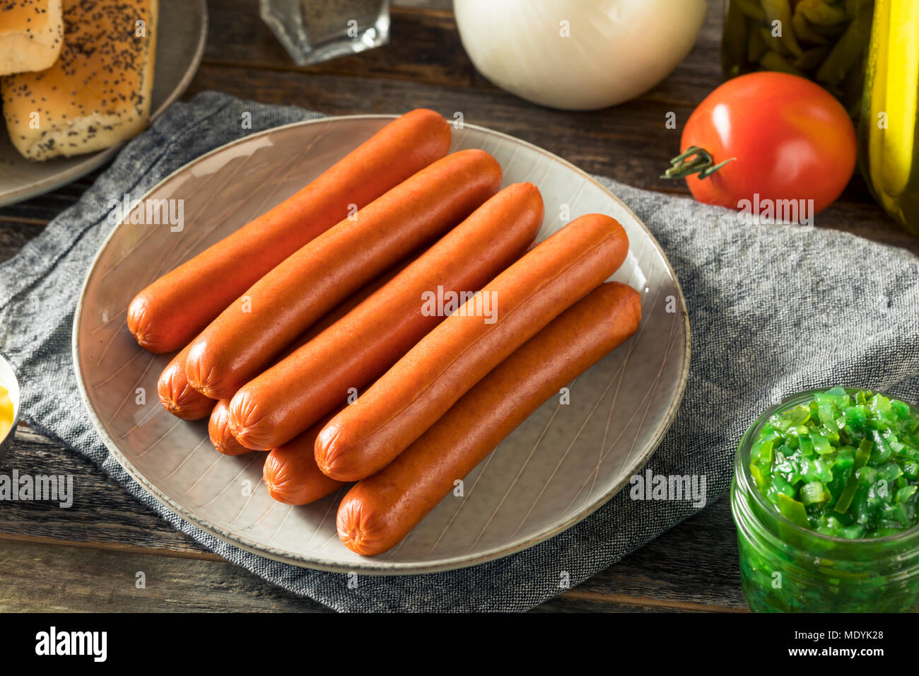 Chicago Style Hot Dog Ingredients with Mustard Pickles Relish Tomato and Peppers - Stock Image