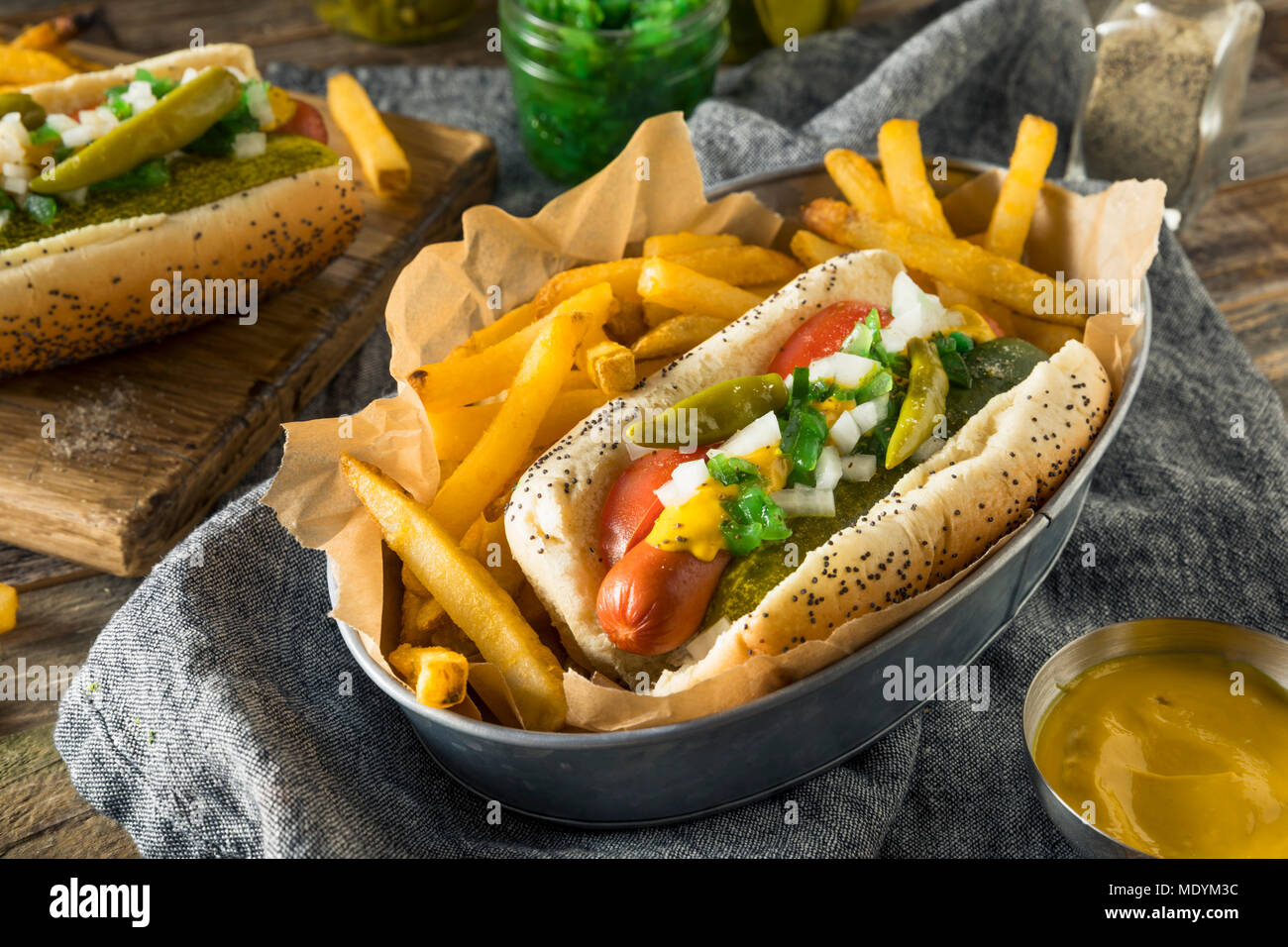 Homemade Chicago Style Hot Dog with Mustard Pickles Relish Tomato and Peppers - Stock Image