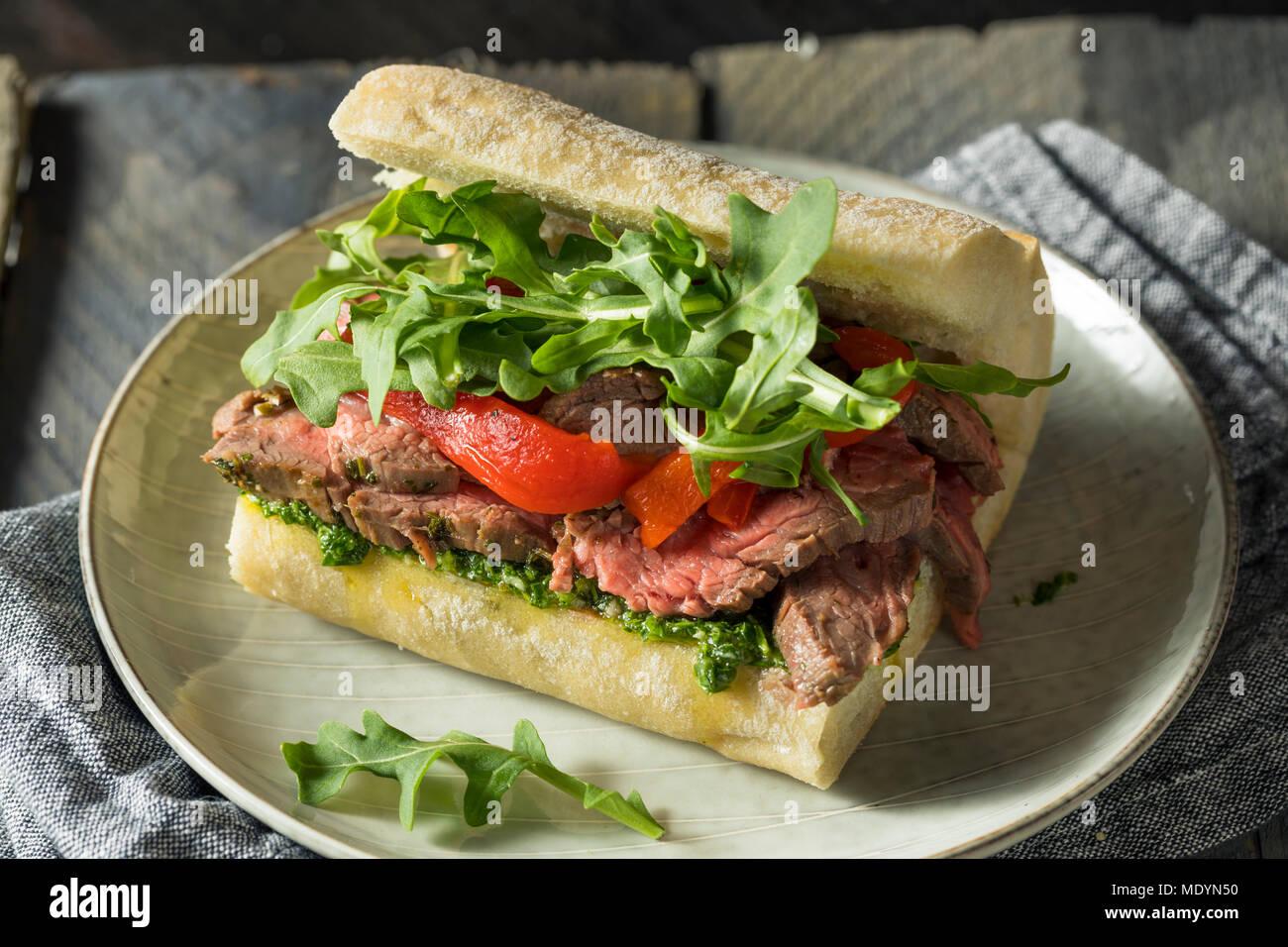 Homemade Beef Steak Sandwich with Chimichurri and Arugula Stock Photo