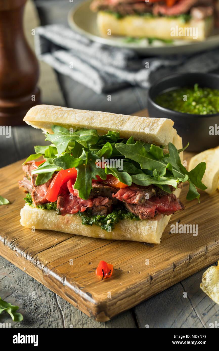 Homemade Beef Steak Sandwich with Chimichurri and Arugula - Stock Image