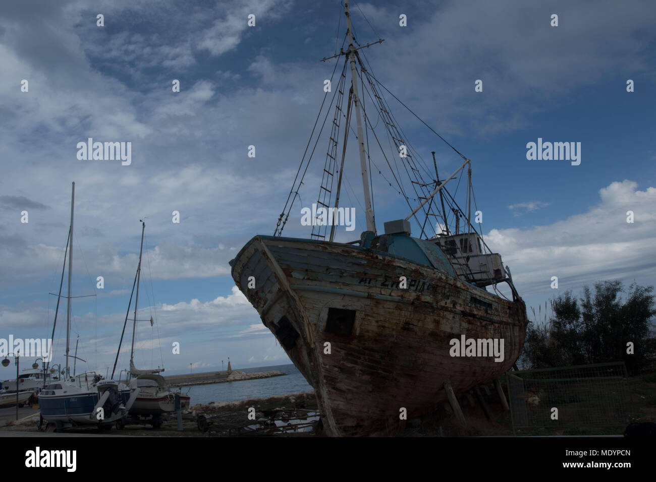 Wooden ship in need of repair, dry dock, Polis, Cyprus - Stock Image