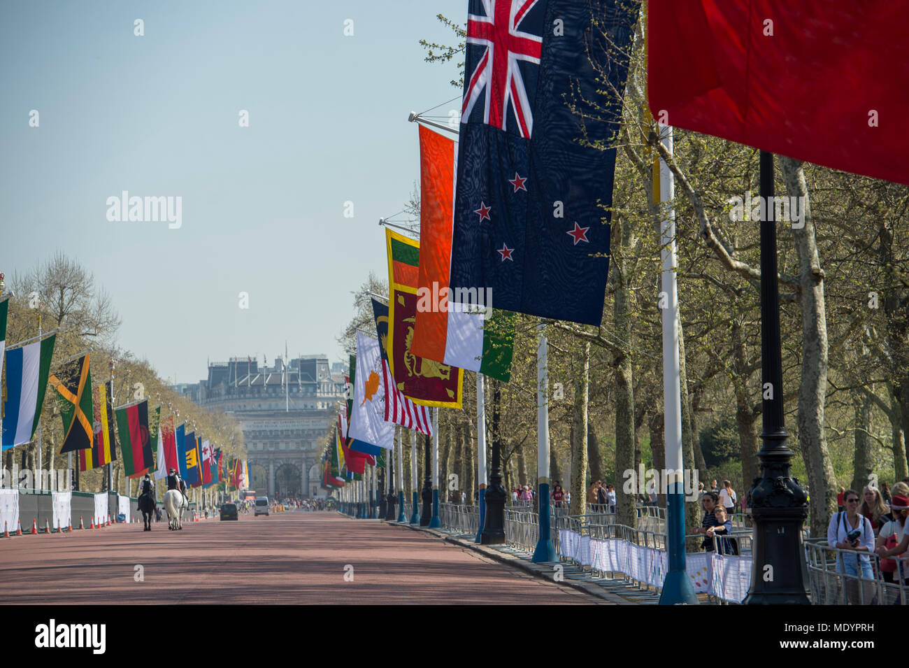 20 April 2018. Hot Spring weather in Green Park with Commonwealth flags lining The Mall for the Heads of Government summit, London, UK - Stock Image
