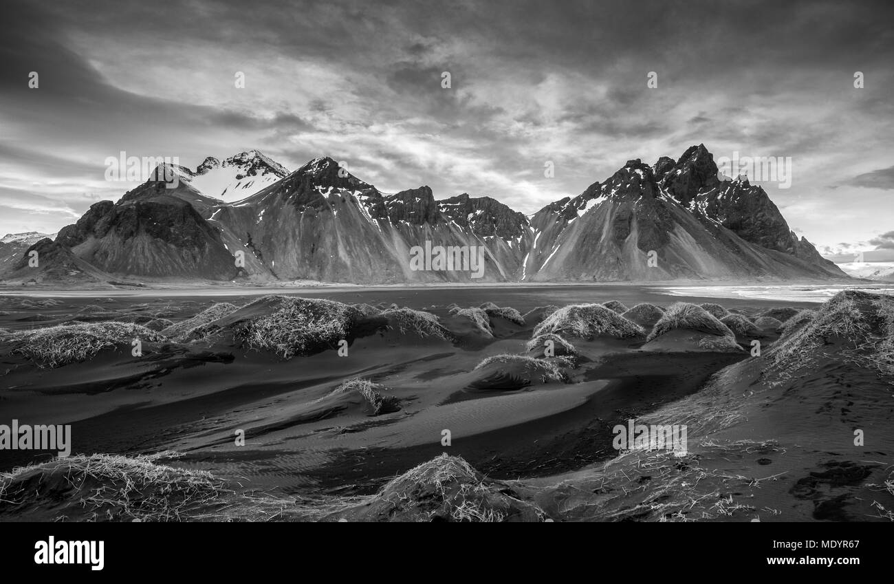 Black and white image of Icelandic Landscape Southern Iceland, Hofn, Stokksnes peninsula with the famous Vestrahorn Mountains and dramatic sky. Stock Photo