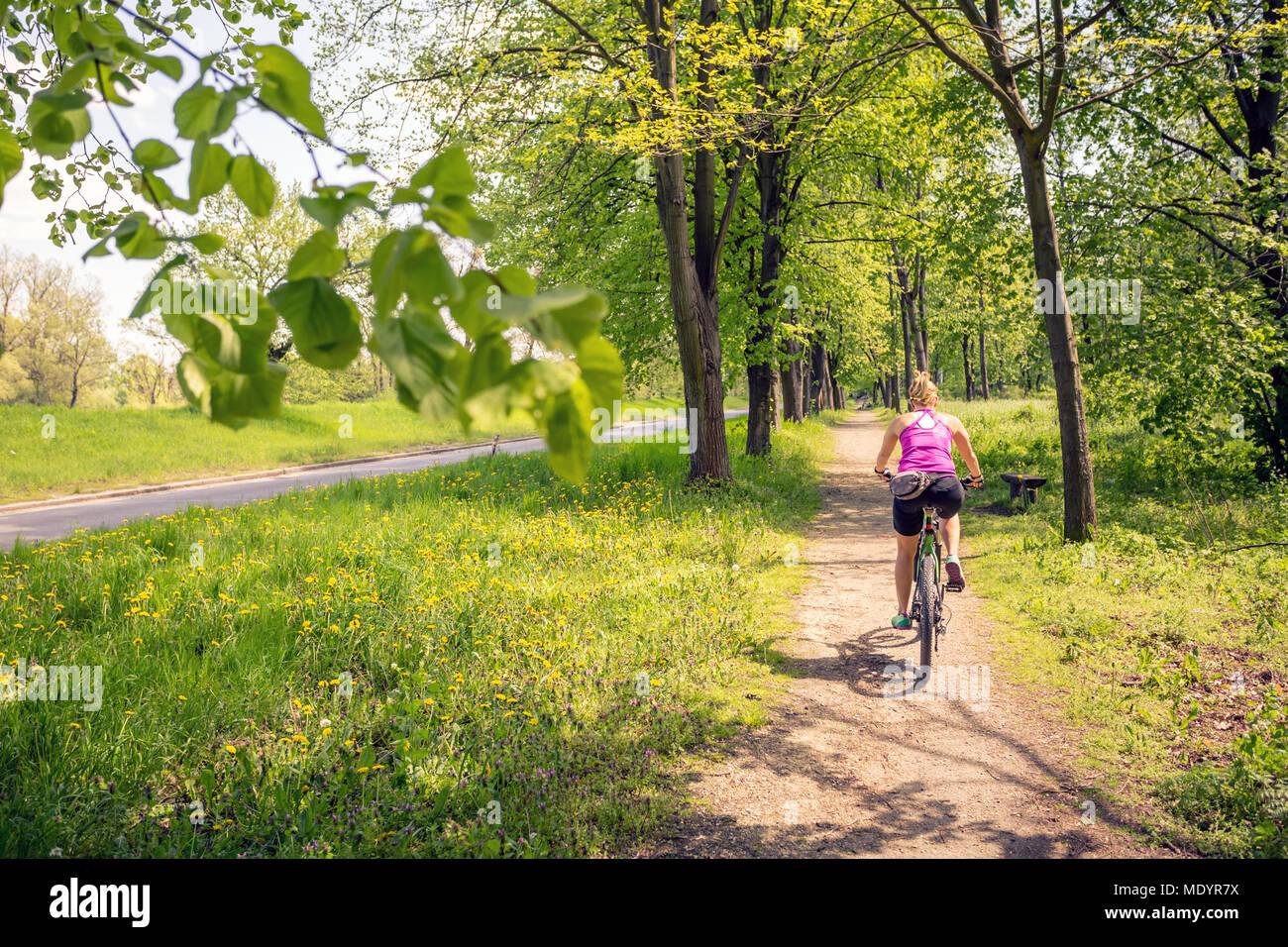 woman-cycling-a-mountain-bike-in-a-city-