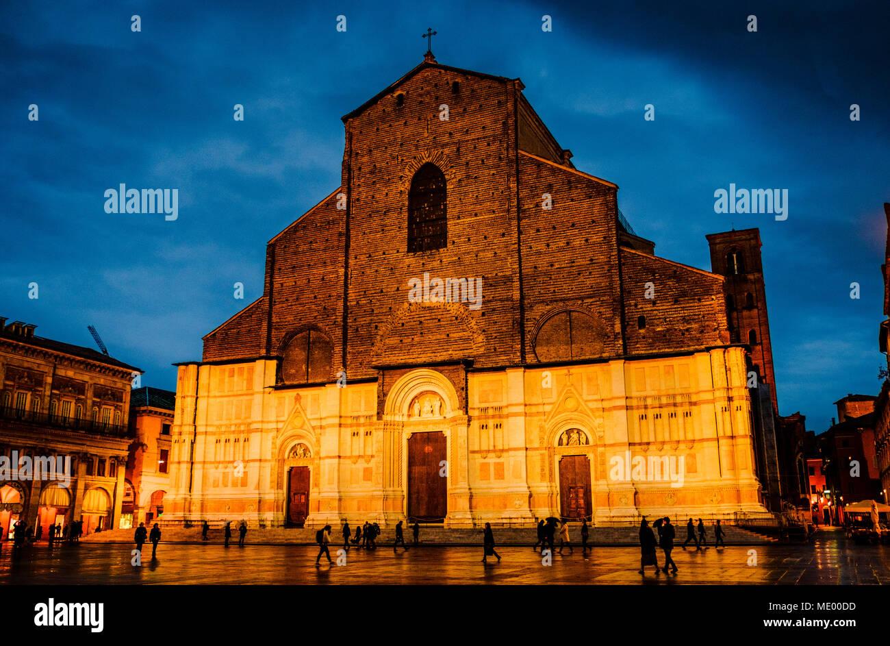 The Basilica di San Petronio floodlit on a wet rainy evening, Bologna, Italy - Stock Image