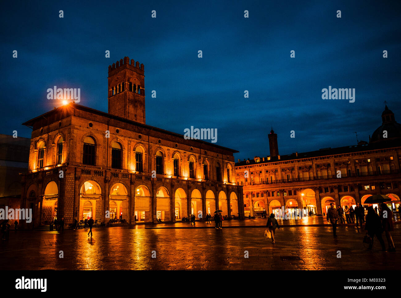 Flooflit buildings in the Piazza Maggiore on a wet rainy evening, Bologna, Italywet evening - Stock Image