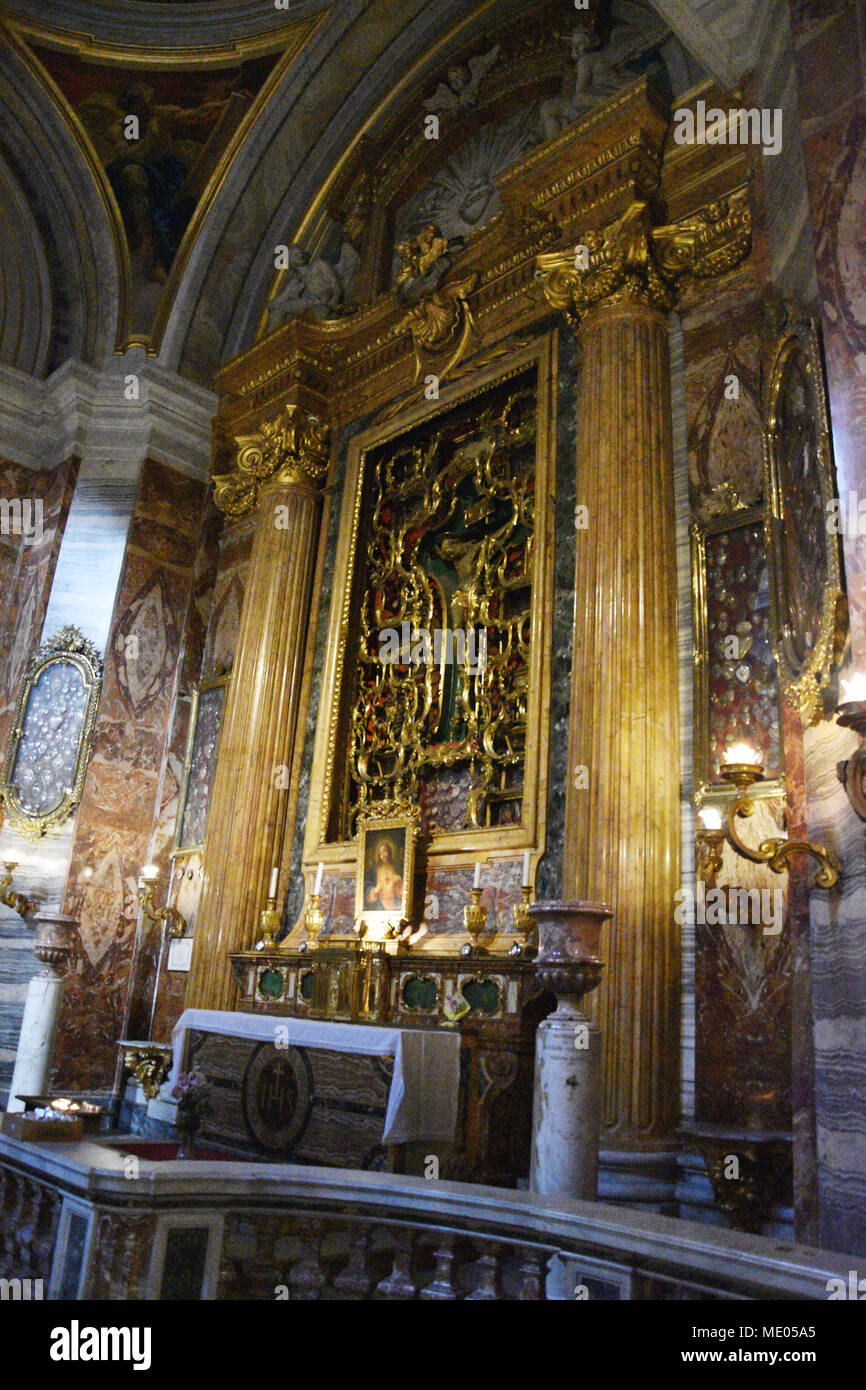 Altar in side chapel with ornate gilded cross screen. The Church of St. Ignatius of Loyola at Campus Martius (Italian: Chiesa di Sant'Ignazio di Loyol - Stock Image