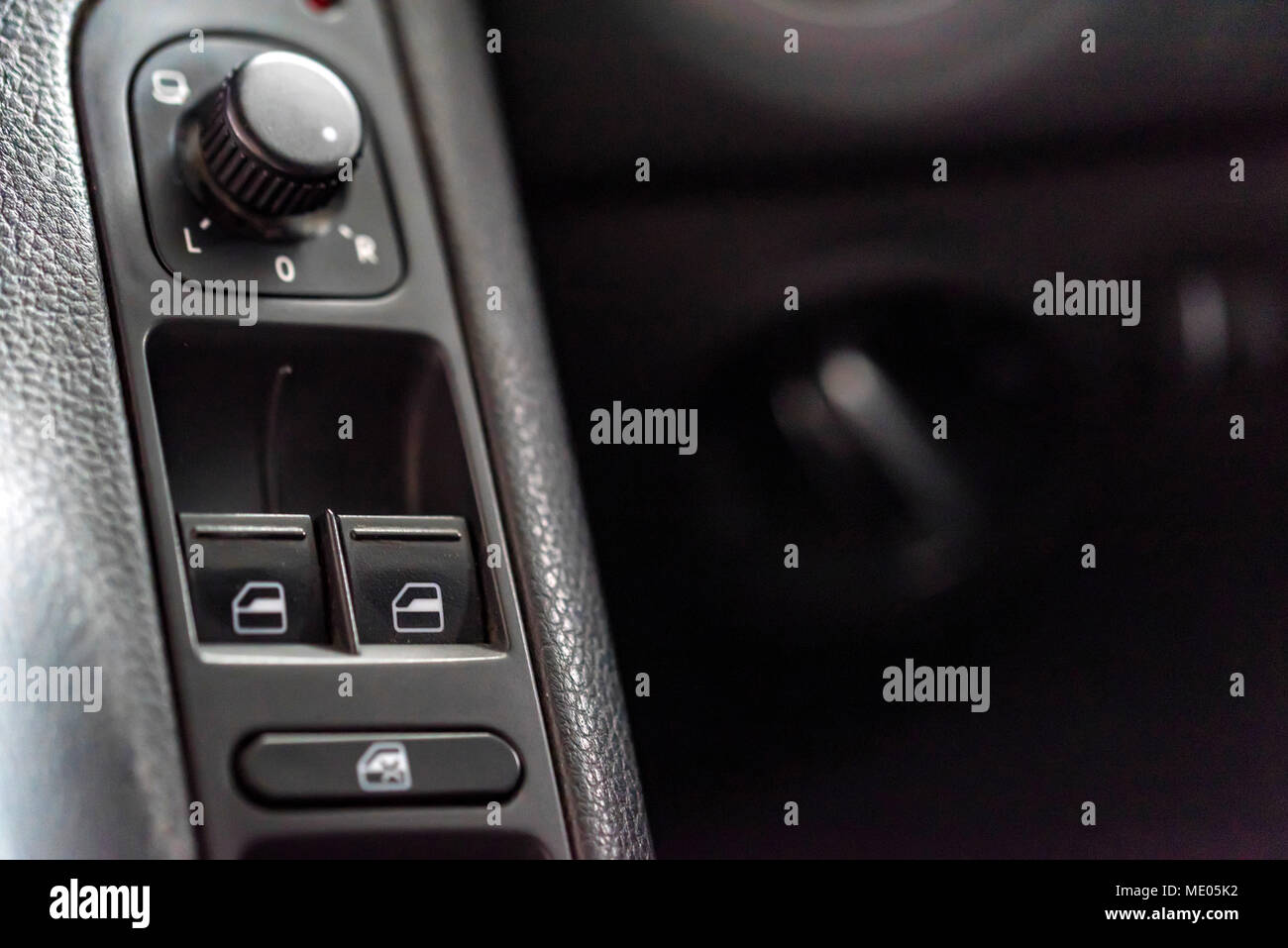Window lifter and mirror adjustment buttons in car - Stock Image
