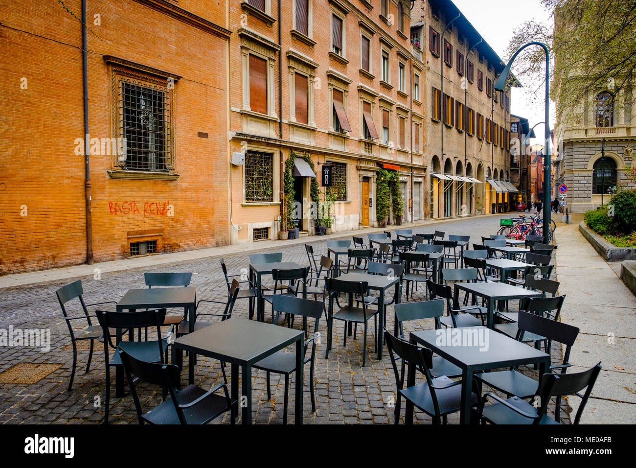 Early morning and empty tables and chairs in the Piazza Minghetti, Bologna, Italy - Stock Image