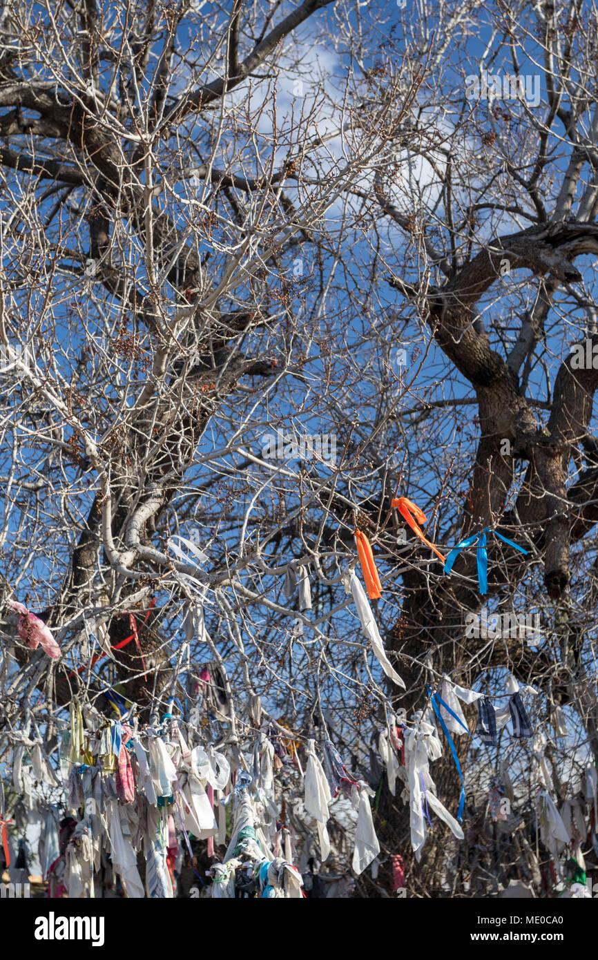 Agia Solomoni Christian Catacomb with ailment curing coloured cloths on the terebinth tree, kato paphos tourist area, paphos cyprus, europe - Stock Image