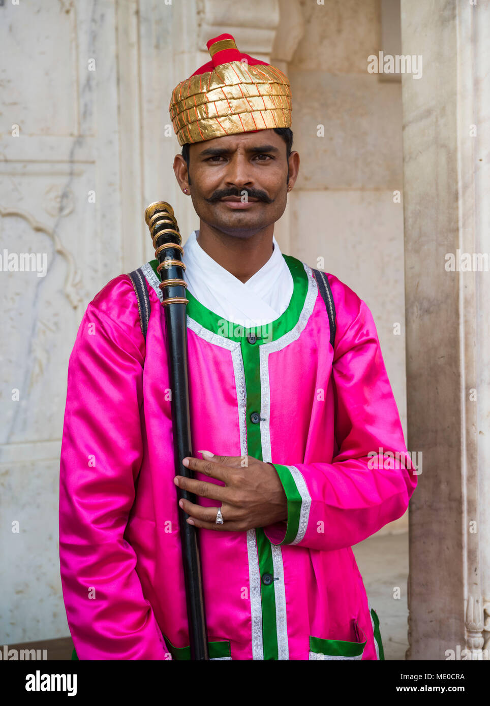 An Indian man in colourful traditional Indian clothing at City Palace; Jaipur, Rajasthan, India - Stock Image