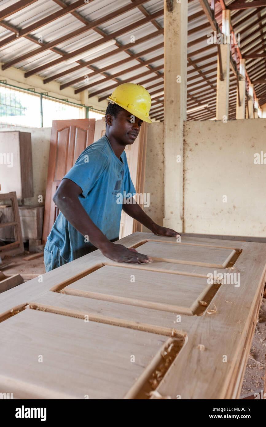 CABINDA/ANGOLA - 08JUN2010 - African carpenter making a door
