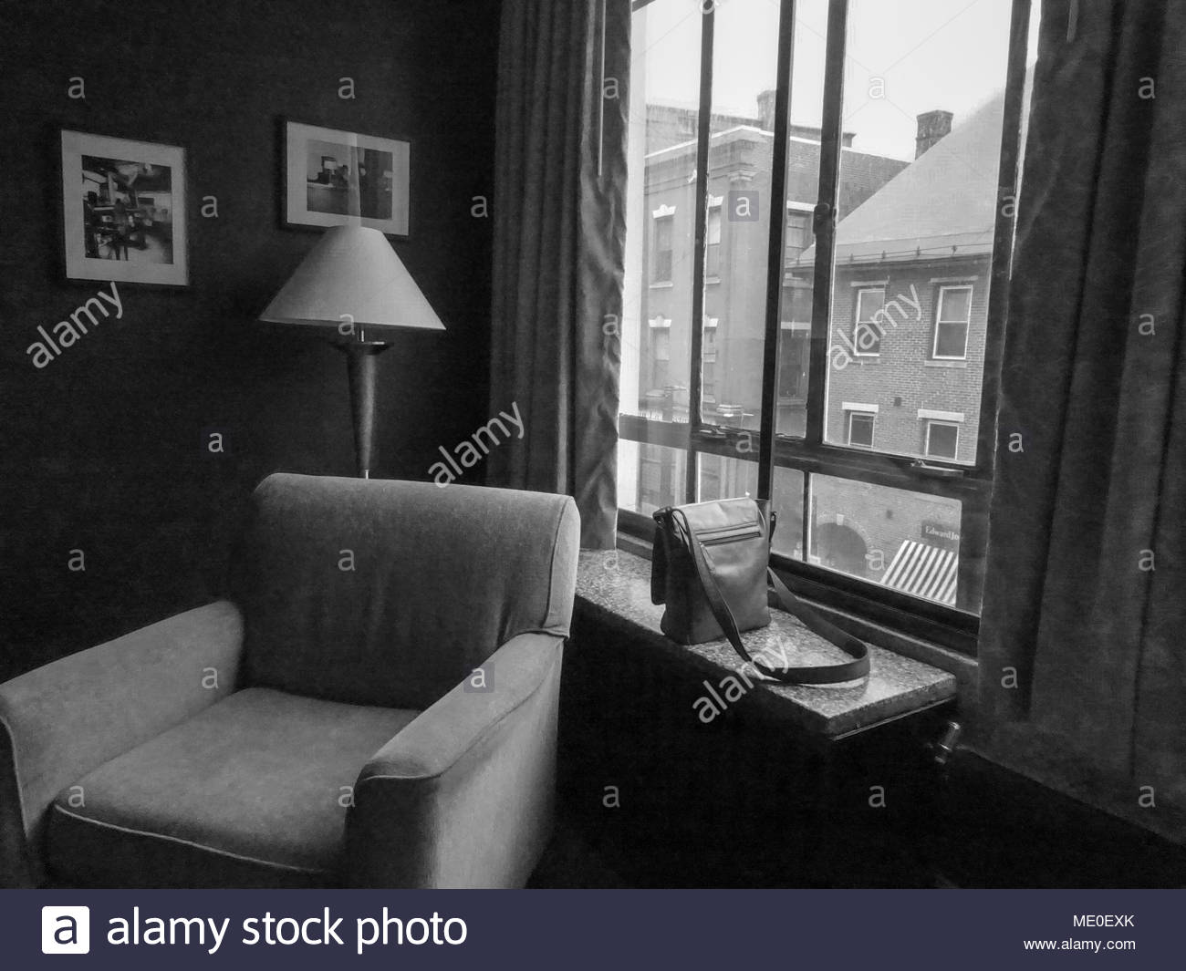 A leather handbag left on a windowsill in a hotel room in Vermont. - Stock Image