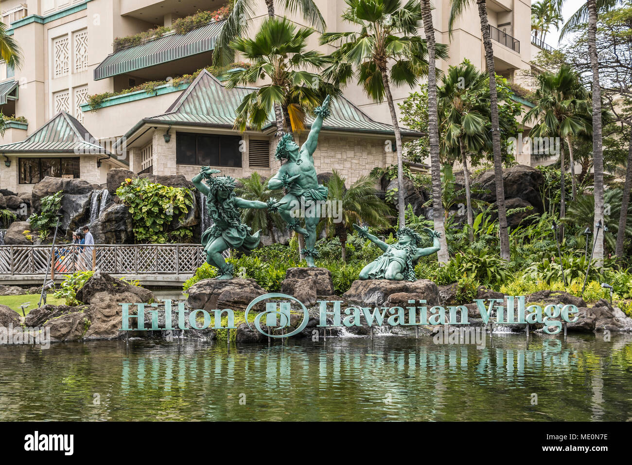 Hula Kahiko dancer statues at Hilton Hawaiian Village, Waikiki; Honolulu, Oahu, Hawaii, United States of America - Stock Image