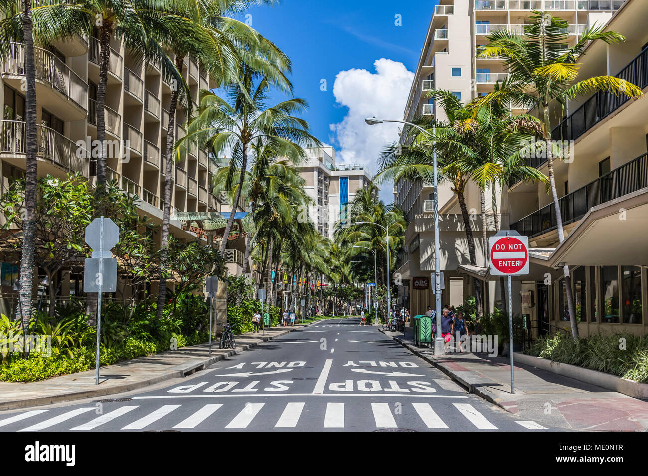 Looking up Levers Street from Kaila Road with Imperial Hawaii Resort at right, Waikiki; Honolulu, Oahu, Hawaii, United States of America - Stock Image