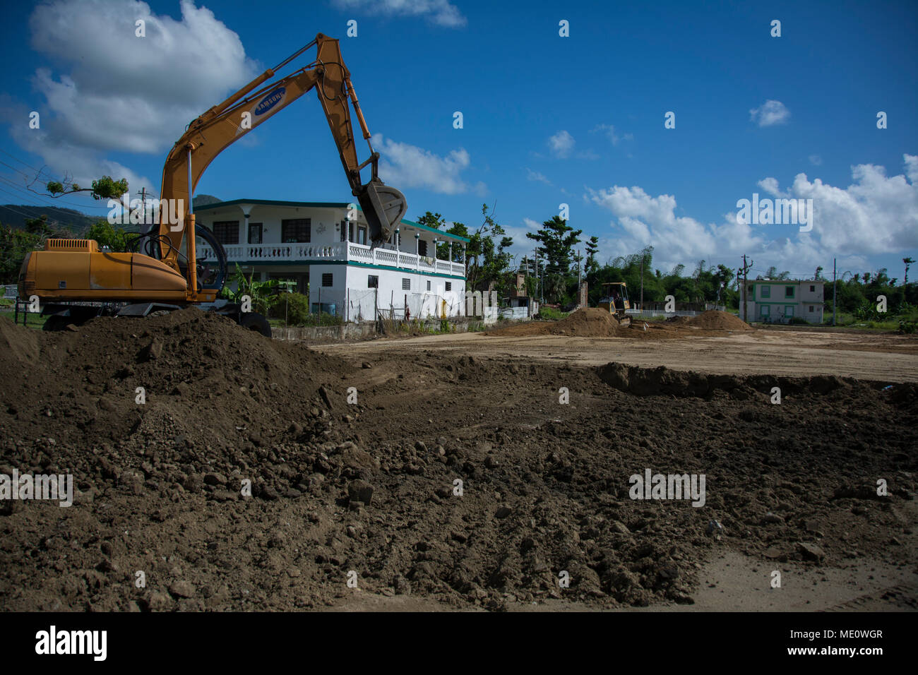 An installation site for a micro grid is prepared in Maunabo, Puerto Rico, on Dec. 17, 2017. The site will host the third micro grid installation on the island, bringing electricity to nearby buildings. The concept is significant in that it is a temporary power mission – usually intended to support critical infrastructure during an emergency – to bringing electricity to residents and businesses. The installation – the second micro grid installed on the island – will be operational by midweek, with the third set to open in nearby Maunabo shortly after. - Stock Image