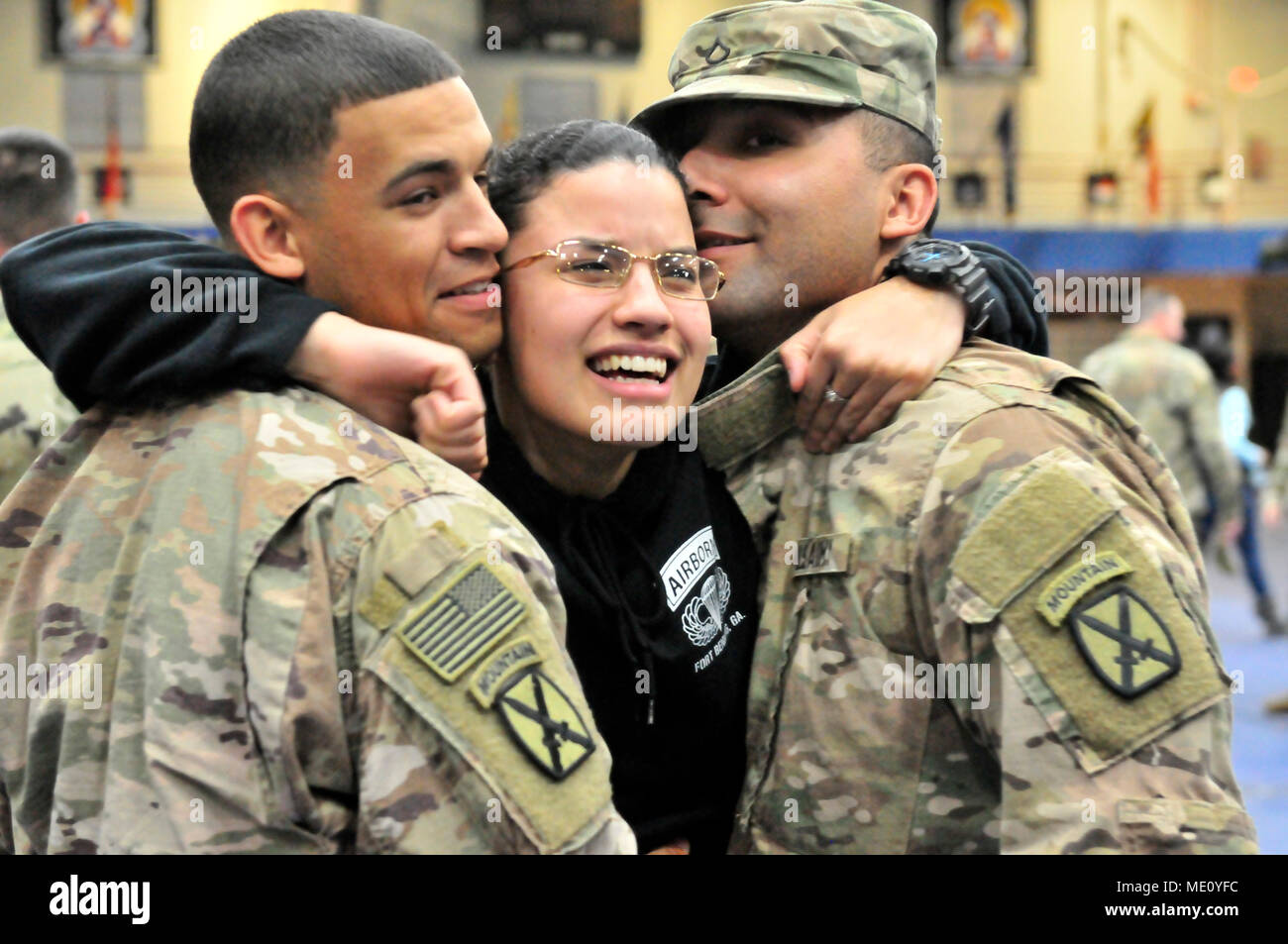 A 548th Combat Sustainment Support Battalion Soldier Middle Embraces Her Friends Spc Terence Powell Left And Pfc Guadalupe Cavazos Right