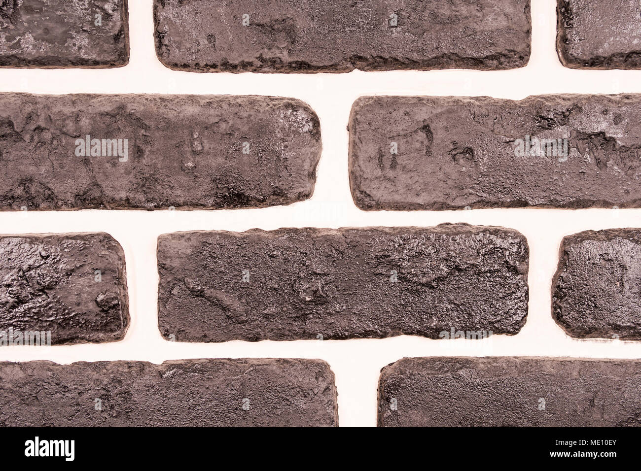 Black Decorative Brick Wall With White Clay Seams Close Up