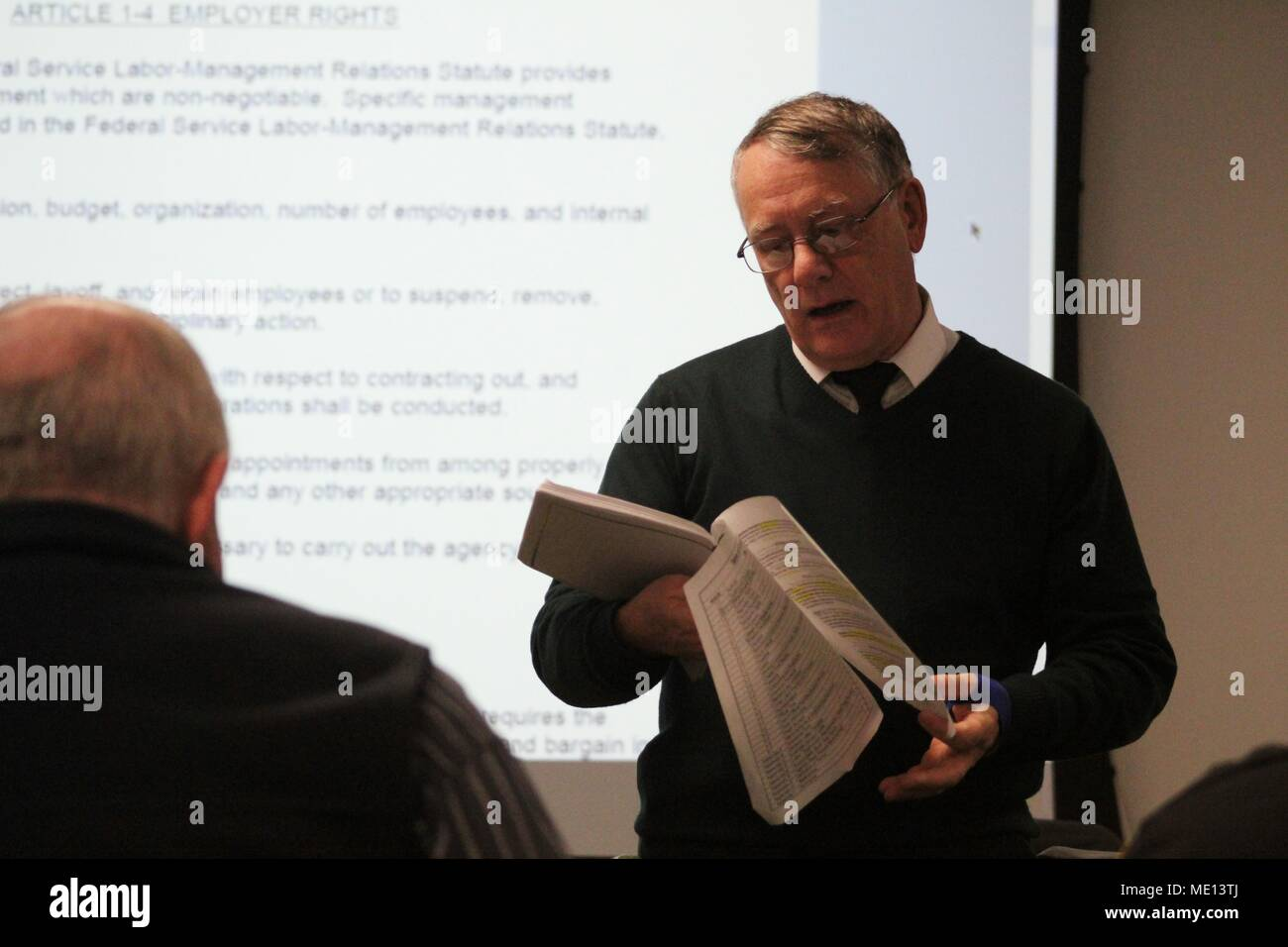 Directorate of Human Resources Director Terry Streeton conducts a training session with Fort McCoy workforce members about the installation's new union collective bargaining agreement Dec. 14, 2017, at Fort McCoy, Wis. The new agreement was finalized earlier in 2017 and the Directorate of Human Resources has held numerous training sessions for employees to help everyone gain a full understanding of what is in the agreement. (U.S. Army Photo by Scott T. Sturkol, Public Affairs Office, Fort McCoy, Wis.) - Stock Image