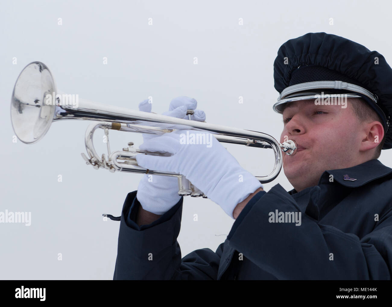 A member of the Fairchild Air Force Base Honor Guard plays taps ...