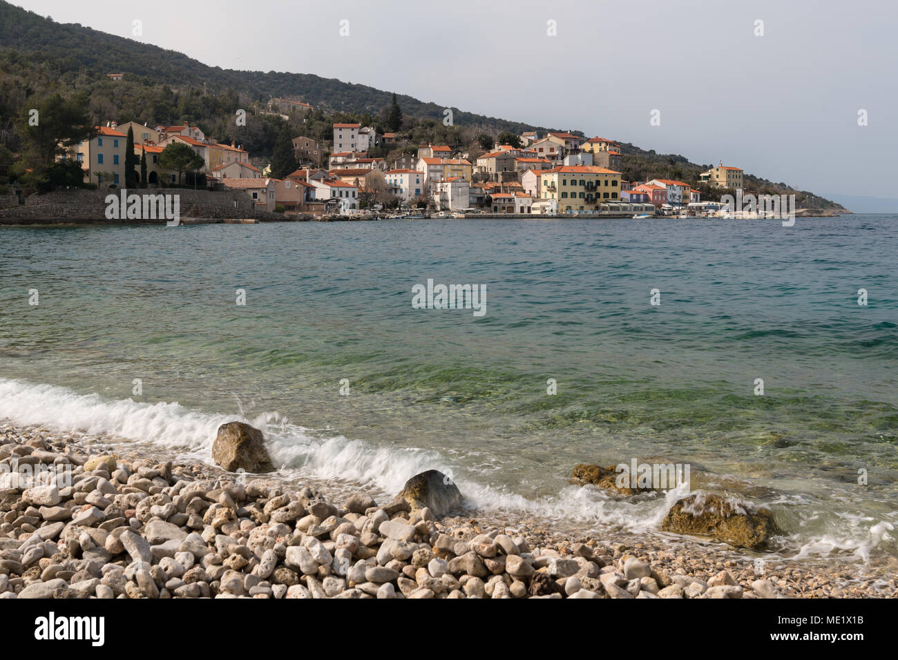 The beach of Valun (Island Cres, Croatia) on a cloudy day in spring Stock Photo