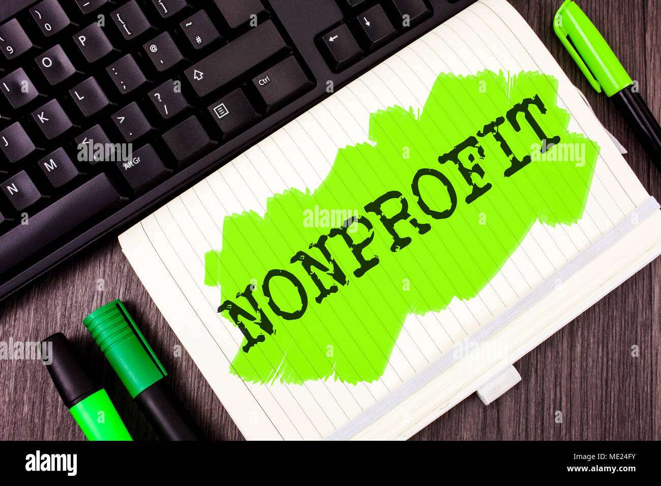 Handwriting text writing Nonprofit. Concept meaning Activities that do not generate revenues to the executor written Painted Notebook Book wooden back - Stock Image