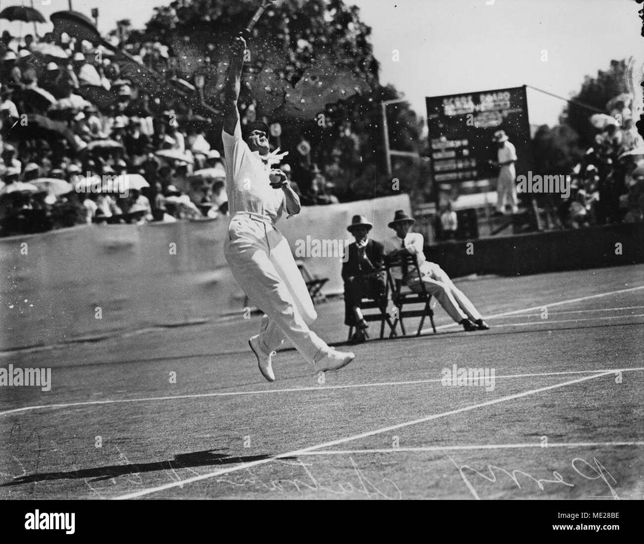 Fred Perry hitting an overhead smash against Australia, 1933. - Stock Image