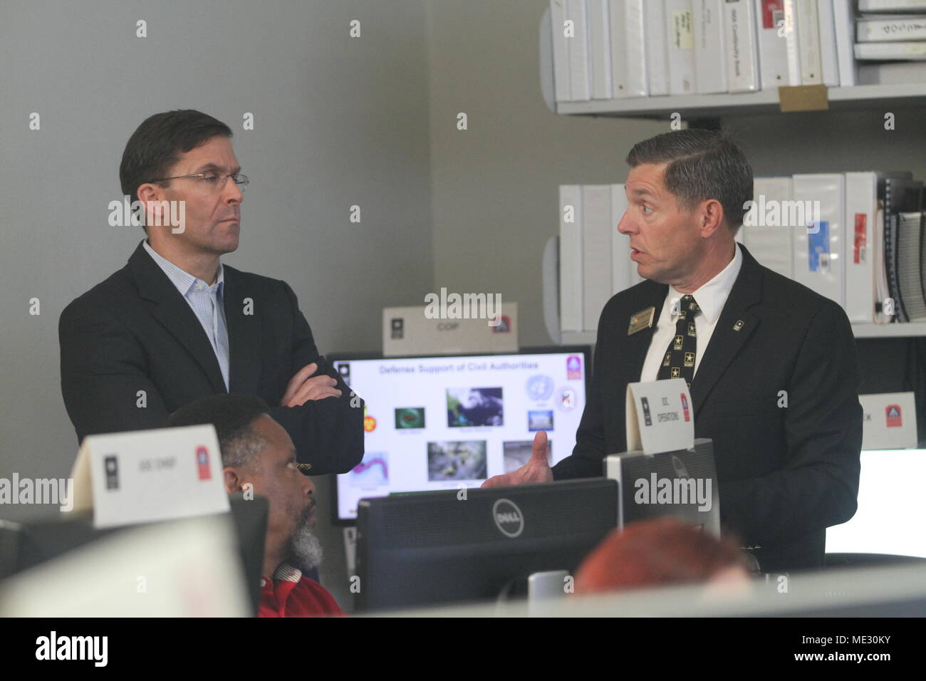 Charles Canedy, the chief of the commander's action group for U.S. Army North (Fifth Army), briefs the 23rd Secretary of the Army, Dr. Mark T. Esper on the functionality of ARNORTH's Defense Support of Civil Authorities mission Apr. 17 at the Joint Operations Center inside the historic Quadrangle at Fort Sam Houston, Texas. The DSCA mission focuses on the Department of Defense's Chemical, Biological, Radiological and Nuclear Response Enterprise, which provides support to the federal lead agency in the event of a catastrophic, national disaster. (Photo by Staff Sgt. Tomora Nance, U.S. Army Nort Stock Photo