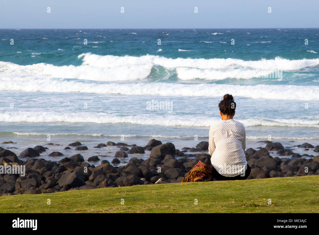 Girl watching the sea on the Gold Coast in Australia - Stock Image