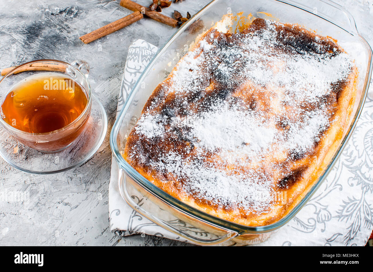 cottage cheese casserole with  tea on a wooden table. health or diet concept.selective focus - Stock Image