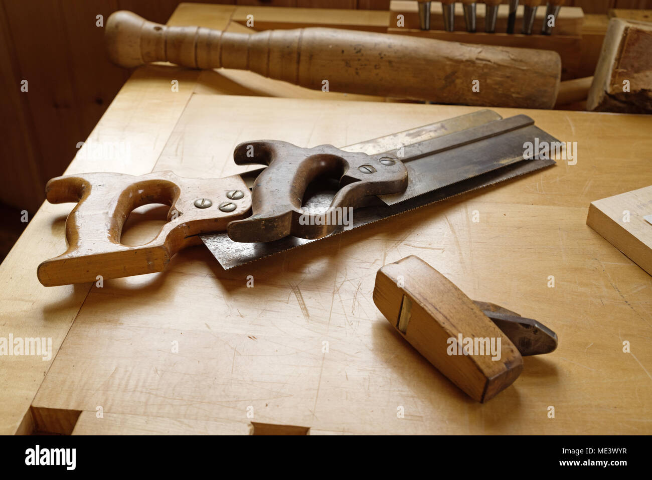 old vintage woodworking tools on a wood workbench - Stock Image