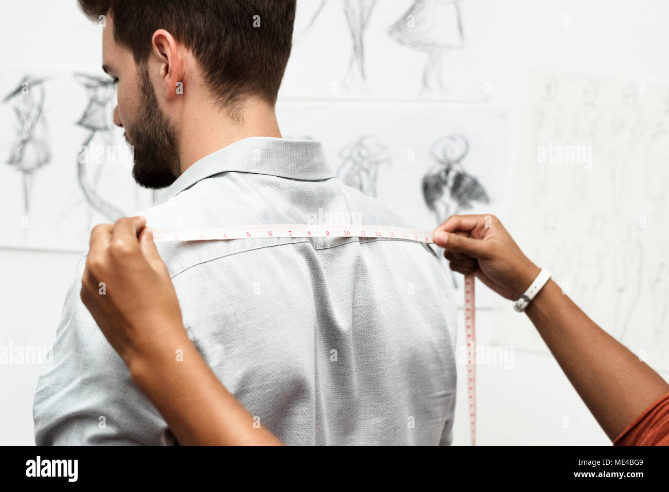 Tailor measuring the body size - Stock Image