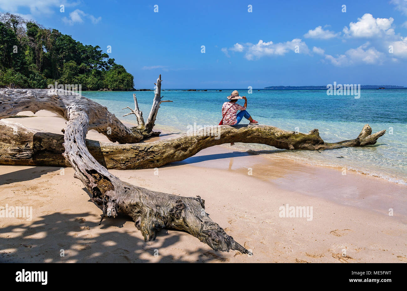 Young female model tourist pose at the Jolly Buoy island beach at Andaman India. - Stock Image