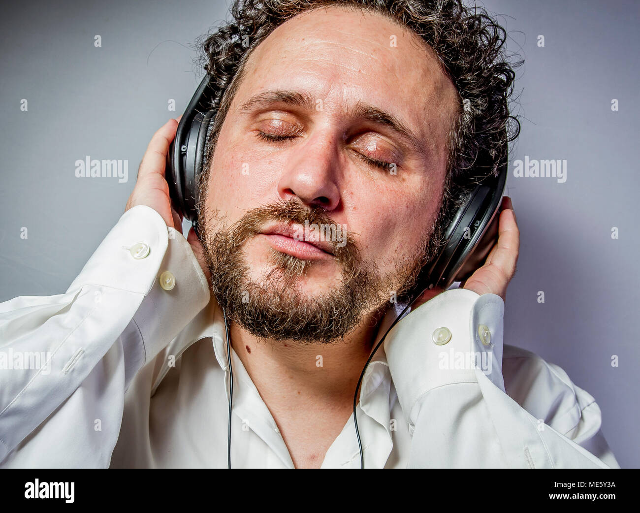 classical music, man with intense expression, white shirt Stock