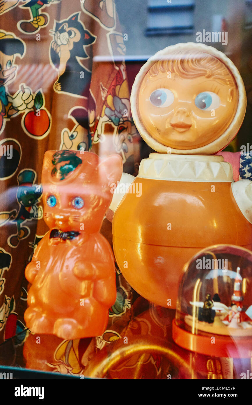 Old secondhand East German / Russian toys displayed in a shop window in Berlin Germany EU. - Stock Image