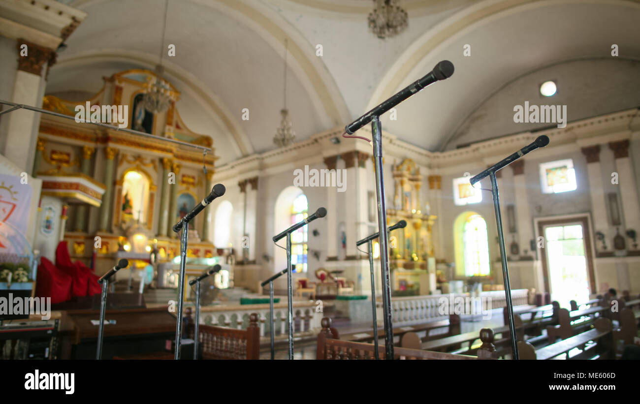Numerous microphones for the church choir in one of the churches of the Philippines. - Stock Image